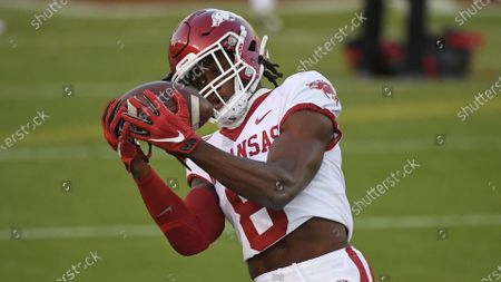 Arkansas wide receiver Mike Woods (8) catches a pass during warmups before an NCAA college football game between Mississippi State and Arkansas in Starkville, Miss