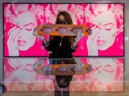 Supreme, New York, Jeff Koons skateboar, est £ 800 - 1,200 with Russell Young, Marilyn Crying (Triptych), 2011 est £ 50,000 - 70,000 - Preview of Bonhams' Pop x Culture sale at New Bond Street. The new sale explores Pop, Street Art and the related art forms that swept across the world, influencing fashion, music, and youth culture.