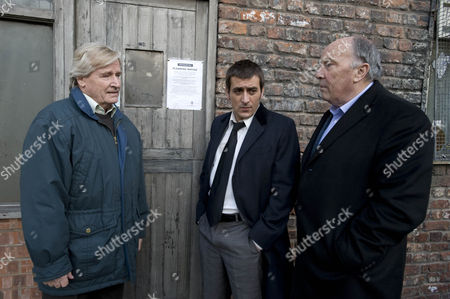 Ken Barlow [William Roache] argues with Peter Barlow [Chris Gascoyne] and George Wilson [Anthony Valentine] when the council put up the planning notice for the bar.