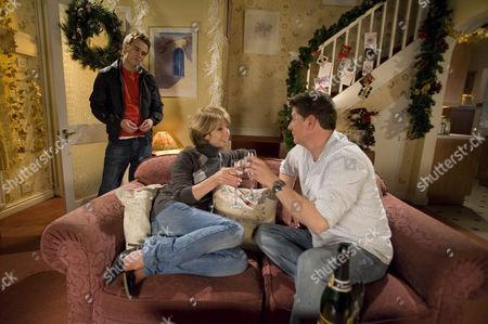 Gail Platt [Helen Worth] and Joe McIntyre [Reece Dinsdale] celebrate selling the house.  David Platt [Jack P Shepherd]  is not pleased when he finds out.