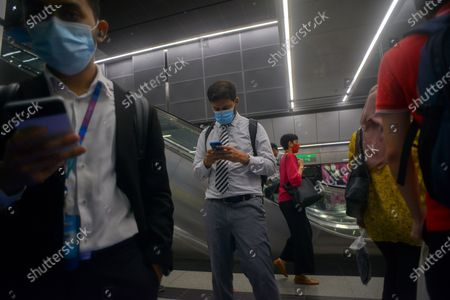 People wearing masks are pictured in a metro station in Kuala Lumpur, Malaysia, Oct. 5, 2020. Malaysian Prime Minister Muhyiddin Yassin said Monday that he will self quarantine for 14 days after a cabinet minister attending a recent meeting he chaired tested positive of COVID-19.     The announcement came when Malaysia reported another daily record high of 432 new COVID-19 infections on Monday, bringing the national total to 12,813.