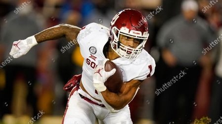 Oklahoma running back Seth McGowan carries the ball up field during the first half of an NCAA college football game against Iowa State, in Ames, Iowa
