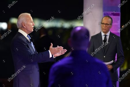 Democratic presidential candidate former Vice President Joe Biden speaks at a NBC Town Hall at Pérez Art Museum, in Miami, with Lester Holt at right