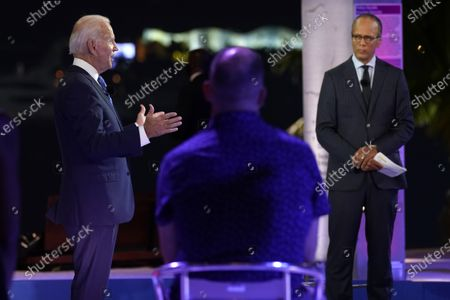 Stock Photo of Democratic presidential candidate former Vice President Joe Biden speaks at a NBC Town Hall at Pérez Art Museum, in Miami, as moderator Lester Holt listens