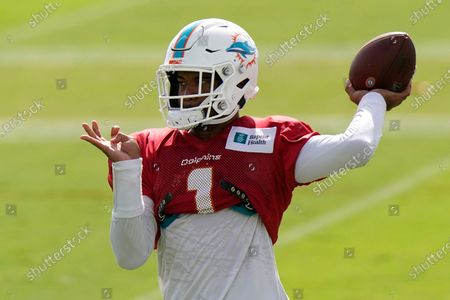 Miami Dolphins quarterback Tua Tagovailoa does drills during practice at the NFL football team's training facility in Davie, Fla. When asked, about the Dolphins' quarterback situation, coach Brian Flores paused for eight seconds he answered. That was plenty of time to stir up even more speculation regarding when top draft pick Tagovailoa might make his NFL debut