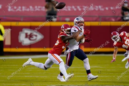 Kansas City Chiefs cornerback Charvarius Ward, left, breaks up a pass intended for New England Patriots wide receiver Julian Edelman during the first half of an NFL football game, in Kansas City