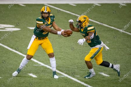 North Dakota State quarterback Trey Lance, left, hands the ball off to running back Seth Wilson on a rush play against Central Arkansas in the second quarter an NCAA college football game, in Fargo, N.D. North Dakota State won 39-28