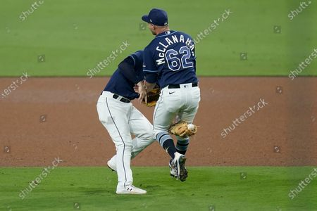 Tampa Bay Rays pitcher Shane McClanahan (62) and second baseman Brandon Lowe collide while chasing down a short pop-up by New York Yankees' Brett Gardner during the ninth inning in Game one of a baseball American League Division Series, in San Diego