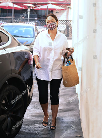 Stock Image of Lindsay Price is seen paying for parking