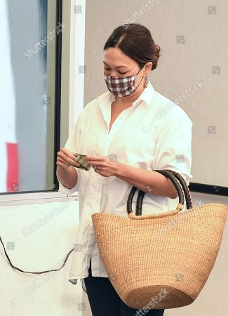 Lindsay Price is seen paying for parking