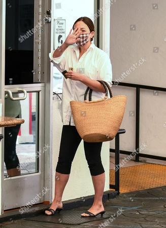 Stock Photo of Lindsay Price is seen paying for parking