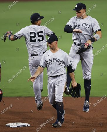 New York Yankees (L-R) Gleyber Torres, Brett Gardner and Aaron Judge celebrate after defeating the Tampa Bay Rays in their American League Division Series playoff game one at Petco Park in San Diego, California, USA, 05 October 2020.