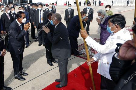 King of Cambodia Norodom Sihamoni (C) greets Prime Minister Hun Sen (L) as he prepares to board a plane at Phnom Penh International Airport in Phnom Penh, Cambodia, 06 October 2020. The King and his mother are heading to China for a health check-up.