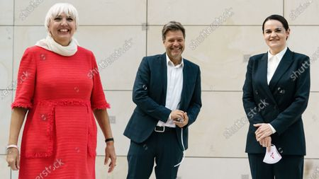 (L-R) Vice President of the German Parliament Claudia Roth, Green party (Die Gruenen) co-chairman Robert Habeck and Belarusian opposition leader Svetlana Tikhanovskaya pose for photographers as they attend a Green Party (Buendnis 90/Die Gruenen) faction meeting at the Reichstag building, the seat of the German Parliament, in Berlin, Germany, 06 October 2020. Belarusian opposition leader Svetlana Tikhanovskaya is on a visit to Berlin at the moment.