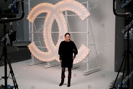 Stock Photo of French novelist Anne Berest poses before Chanel Spring-Summer 2021 fashion collection presented in Paris