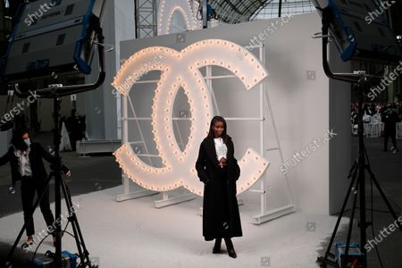 French actress Karidja Toure poses poses before the presentation of Chanel Spring-Summer 2021 fashion collection, in Paris