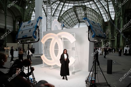 Stock Picture of French actress Karidja Toure poses poses before the presentation of Chanel Spring-Summer 2021 fashion collection, in Paris