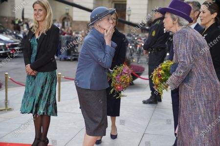 Queen Margrethe II of Denmark (C) throws a hand kiss to her younger sister Princess Benedikte (2-R) and Crown Princess Mary (R) as they arrive at the stairs of Christiansborg Castle in Copenhagen, before the official opening of the Danish Parliament in Copenhagen, Denmark, 06 October 2020.