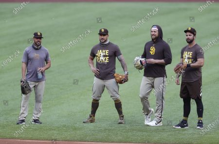 Stock Picture of Manager Jayce Tingler, coach Skip Schumaker, Trevor Rosenthal and Greg Garcia of the San Diego Padres talk during a practice for the NLDS
