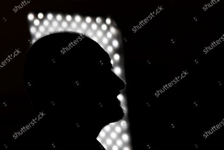 Stock Photo of Spanish writer Arturo Perez-Reverte is silhouetted against a window during the presentation of his new novel 'Linea de Fuego' (lit. Line of Fire) in Madrid, Spain, 06 October 2020.