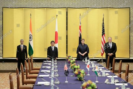 Subrahmanyam Jaishankar, India's foreign minister, from (L), Toshimitsu Motegi, Japan's foreign minister, Marise Payne, Australia's foreign minister, and Michael Pompeo, U.S. Secretary of State, pose for a photograph prior to the Quadrilateral Security Dialogue (Quad) ministerial meeting in Tokyo, Japan, 06 October 2020.