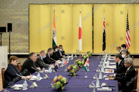 Michael Pompeo, U.S. Secretary of State, (2L), speaks to Toshimitsu Motegi, Japan's foreign minister, (2R), Subrahmanyam Jaishankar, India's foreign minister, (R), and Marise Payne, Australia's foreign minister, left, during the Quadrilateral Security Dialogue (Quad) ministerial meeting in Tokyo, Japan, 06 October 2020.