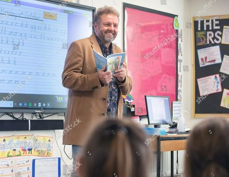 Martin Roberts launches a nationwide schools initiative at Paulton Junior School, Bristol. All 22,500 UK primary schools will receive the specially created teaching version of Martins book, 'Sadsville'. The book is aimed at helping children understand their emotions and why they might be struggling with unhappiness. In addition to providing complementary teaching material, the book will also guide children in ways to feel happier and where to find support. Martin Roberts reading to year three children.