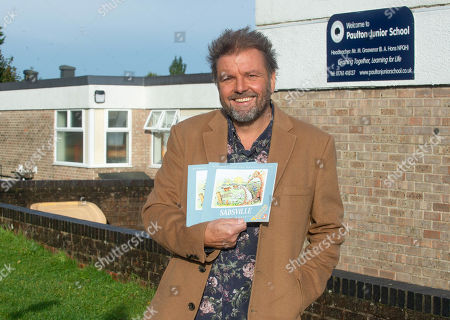 Stock Picture of Martin Roberts launches a nationwide schools initiative at Paulton Junior School, Bristol. All 22,500 UK primary schools will receive the specially created teaching version of Martins book, 'Sadsville'. The book is aimed at helping children understand their emotions and why they might me struggling with unhappiness. In addition to providing complementary teaching material, the book will also guide children in ways to feel happier and where to find support.