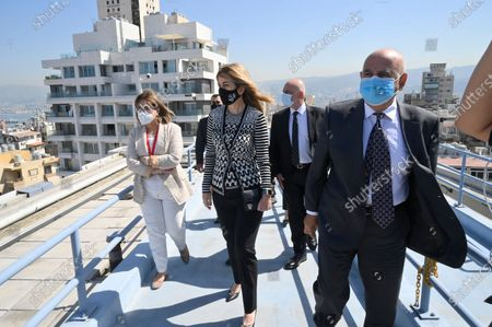 The Chairperson of the King Hussein Cancer Foundation and Center in Amman-Jordan Princess Ghida Talal (C) walks with Lebanese doctors on a rooftop during her visit to the Saint George Hospital University Medical Center (Al-Roum hospital) after the massive explosion rocked Beirut port at Ashrafieh in Beirut, Lebanon, 06 October 2020. At least 190 people were killed, and more than six thousand injured in the Beirut blast that devastated the port area on 04 August and believed to have been caused by an estimated 2,750 tons of ammonium nitrate stored in a warehouse. The explosion damaged some 50 thousand housing units, and left 300 thousand people homeless. Preparations for the restoration of partially damaged buildings began in the areas of Karantina, Gemmayze, and Mar Mikhael facing the port of Beirut.