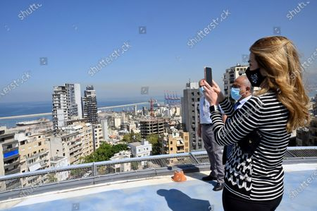 The Chairperson of the King Hussein Cancer Foundation and Center in Amman-Jordan Princess Ghida Talal uses her phone to takes a picture to the Harbour area during her visit to the Saint George Hospital University Medical Center (Al-Roum hospital) after the massive explosion rocked Beirut port at Ashrafieh in Beirut, Lebanon, 06 October 2020. At least 190 people were killed, and more than six thousand injured in the Beirut blast that devastated the port area on 04 August and believed to have been caused by an estimated 2,750 tons of ammonium nitrate stored in a warehouse. The explosion damaged some 50 thousand housing units, and left 300 thousand people homeless. Preparations for the restoration of partially damaged buildings began in the areas of Karantina, Gemmayze, and Mar Mikhael facing the port of Beirut.