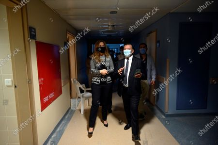 Stock Image of The Chairperson of the King Hussein Cancer Foundation and Center in Amman-Jordan Princess Ghida Talal (L) walks with a Lebanese doctor during her visit to the Saint George Hospital University Medical Center (Al-Roum hospital) after the massive explosion rocked Beirut port at Ashrafieh in Beirut, Lebanon, 06 October 2020. At least 190 people were killed, and more than six thousand injured in the Beirut blast that devastated the port area on 04 August and believed to have been caused by an estimated 2,750 tons of ammonium nitrate stored in a warehouse. The explosion damaged some 50 thousand housing units, and left 300 thousand people homeless. Preparations for the restoration of partially damaged buildings began in the areas of Karantina, Gemmayze, and Mar Mikhael facing the port of Beirut.