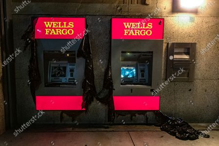 Wells Fargo ATMs are damaged during a protest of the murder of Jonathan Price by Texas police officer Shaun David Lucas