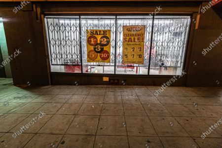 A storefront is damaged during a protest of the murder of Jonathan Price by Texas police officer Shaun David Lucas