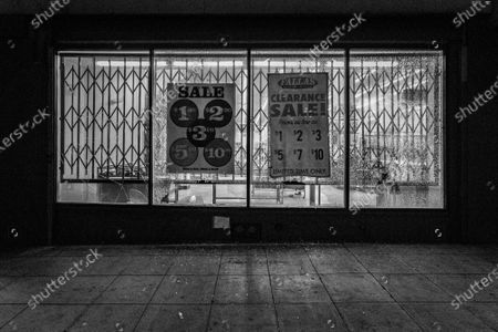 Stock Photo of A storefront is damaged during a protest of the murder of Jonathan Price by Texas police officer Shaun David Lucas