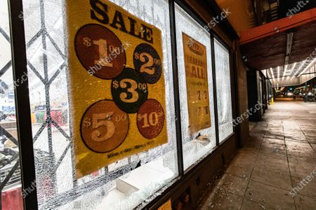 Stock Image of A storefront is damaged during a protest of the murder of Jonathan Price by Texas police officer Shaun David Lucas
