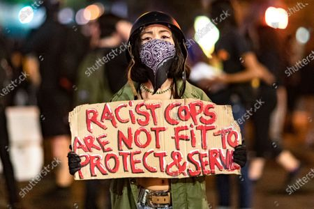Stock Image of People march in protest of the murder of Jonathan Price by Texas police officer Shaun David Lucas