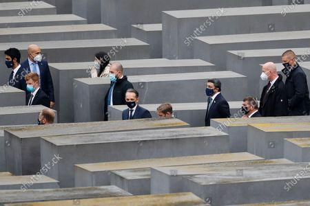 German Foreign Minister Heiko Maas, center, visits with his counterparts from Israel Gabi Ashkenazi, third from right, and the United Arab Emirates Sheikh Abdullah bin Zayed Al Nahyan, forth from right, the Holocaust Memorial during a meeting in Berlin, Germany, . The three foreign minister meet for talks in the German capital