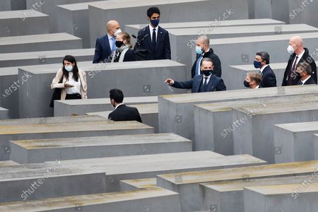 German Foreign Minister Heiko Maas, center, visits with his counterparts from Israel Gabi Ashkenazi, right, and the United Arab Emirates Sheikh Abdullah bin Zayed Al Nahyan, third from right, the Holocaust Memorial during a meeting in Berlin, Germany, . The three foreign minister meet for talks in the German capital