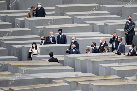 German Foreign Minister Heiko Maas, gestures in center, visits with his counterparts from Israel Gabi Ashkenazi, fourth right from center, and the United Arab Emirates Sheikh Abdullah bin Zayed Al Nahyan, second right from center, the Holocaust Memorial during a meeting in Berlin, Germany, . The three foreign minister meet for talks in the German capital