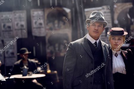 Stock Photo of Luke Evans as John Moore and Dakota Fanning as Sara Howard