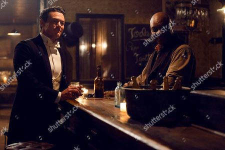 Luke Evans as John Moore and Robert Wisdom as Cyrus Montrose