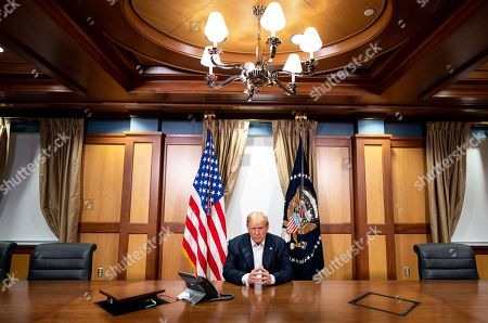 President Donald Trump, joined by Chief of Staff Mark Meadows, participates in a phone call with Vice President Mike Pence, Secretary of Defense Mark Esper, Secretary of State Mike Pompeo, Chairman of the Joint Chiefs of Staff Gen. Mark Milley and National Security Advisor Robert O'Brien Sunday, Oct. 4, 2020, in his conference room at Walter Reed National Military Medical Center in Bethesda, Md