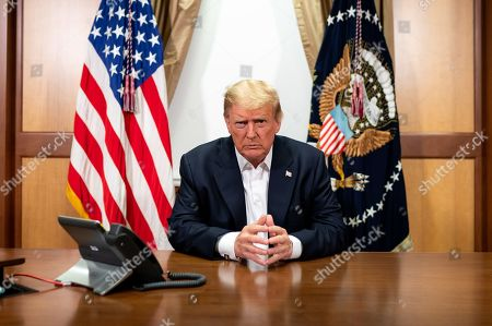 President Donald Trump, joined by Chief of Staff Mark Meadows, participates in a phone call with Vice President Mike Pence, Secretary of Defense Mark Esper, Secretary of State Mike Pompeo, Chairman of the Joint Chiefs of Staff Gen. Mark Milley and National Security Advisor Robert O'Brien Sunday, Oct. 4, 2020, in his conference room at Walter Reed National Military Medical Center in Bethesda, Md.