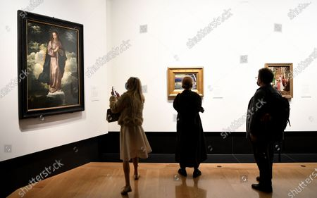 Visitors look at the artwork 'The Immaculate Conception' by Diego Velazquez during a photocall of the exhibition 'Sin' in the National Galley in London, Britain, 06 October 2020. The exhibition will open to the public on 07 October and runs until 03 January 2021.