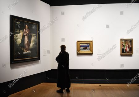A gallery employee poses next to the artwork 'The Immaculate Conception' by Diego Velazquez during a photocall of the exhibition 'Sin' in the National Galley in London, Britain, 06 October 2020. The exhibition will open to the public on 07 October and runs until 03 January 2021.