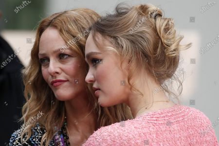 French actress and singer Vanessa Paradis, left, and actress Lily-Rose Depp pose before the presentation of Chanel Spring-Summer 2021 fashion collection, in Paris