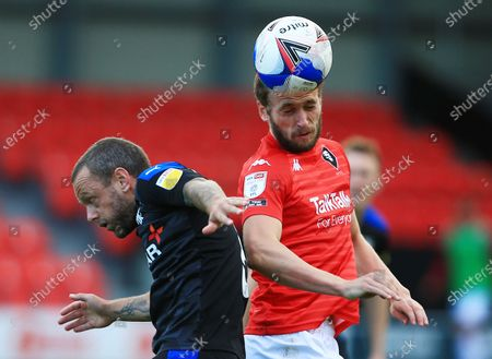 James Wilson of Salford City and Jay Spearing of Tranmere Rovers
