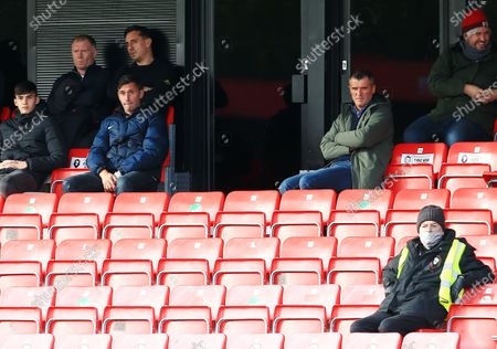 Roy Keane, Gary Neville and Paul Scholes look on from the stand