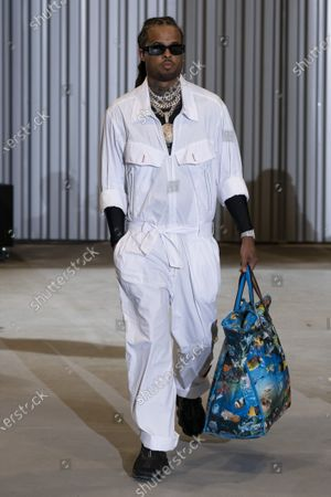 Stock Photo of A Model wearing an outfit from the Womens Ready to wear, pret a porter, collections, summer 2021, original creation, during the Womenswear Fashion Week in Paris, from the house of Xuly Bet