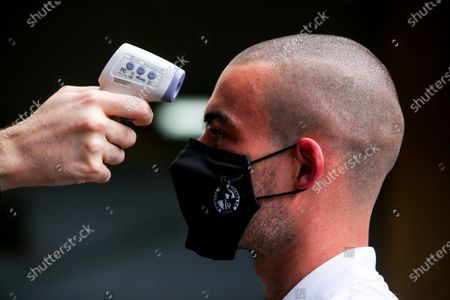 Stock Photo of Michael Kelly of Bristol Rovers arrives at Oxford United and has his temperature checked as part of Covid-19 protocols